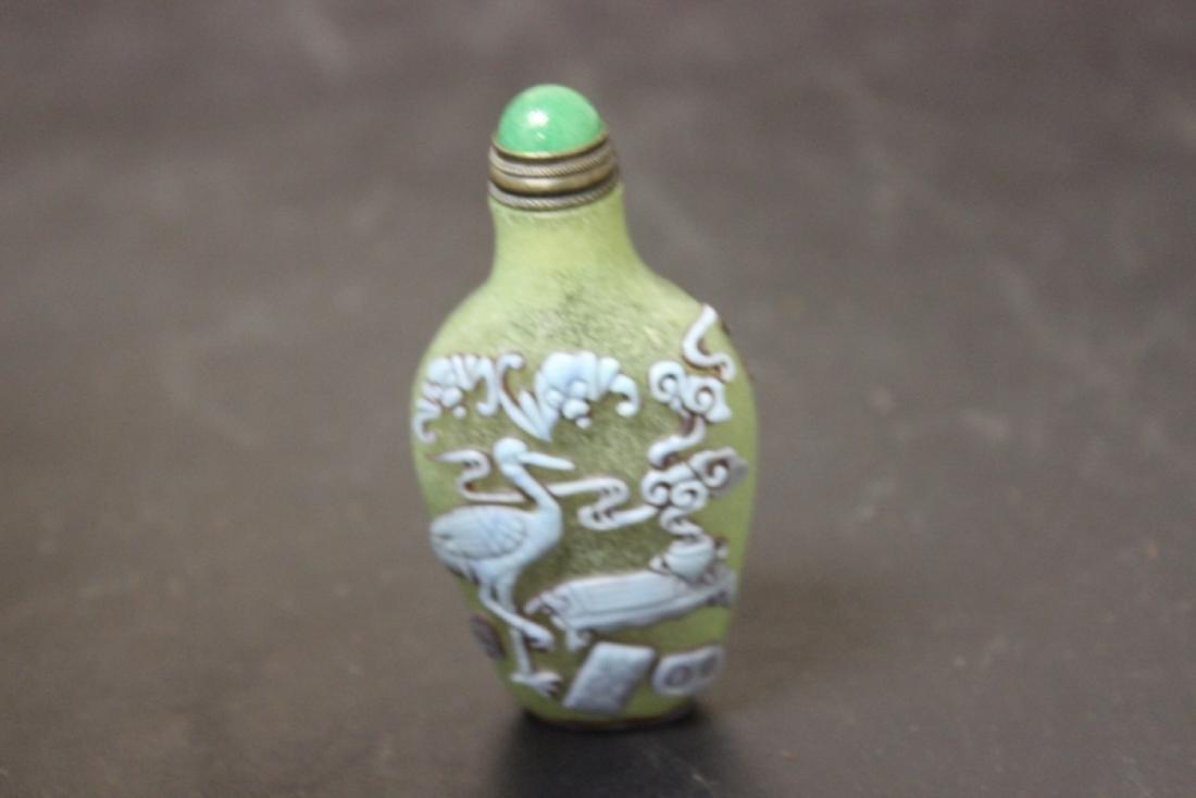 A Chinese Peking Glass Overlay Snuff Bottle