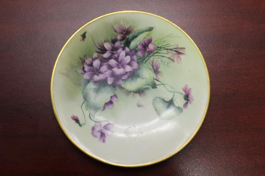 A Signed and Hand Painted Plate