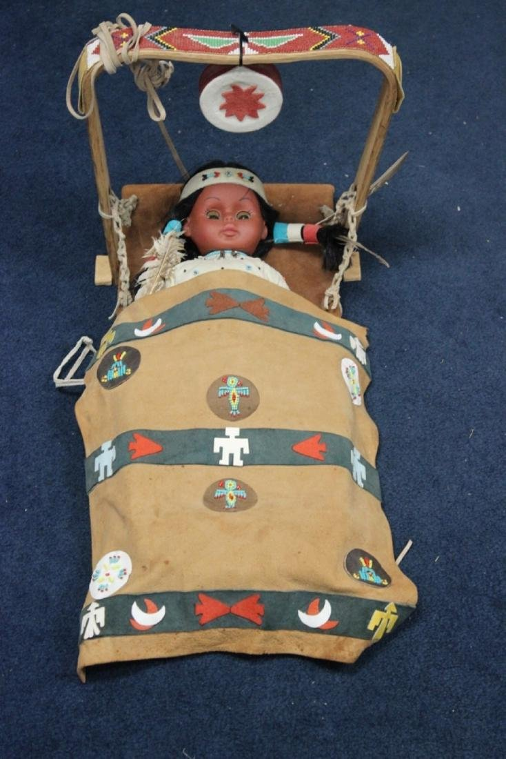 A Native Indian Leather Carlson Doll With Leather
