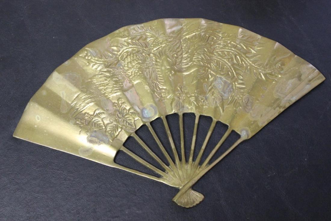 An Oriental Brass Fan Wall Hanger