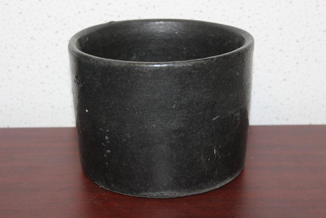 A Black Pottery Crock