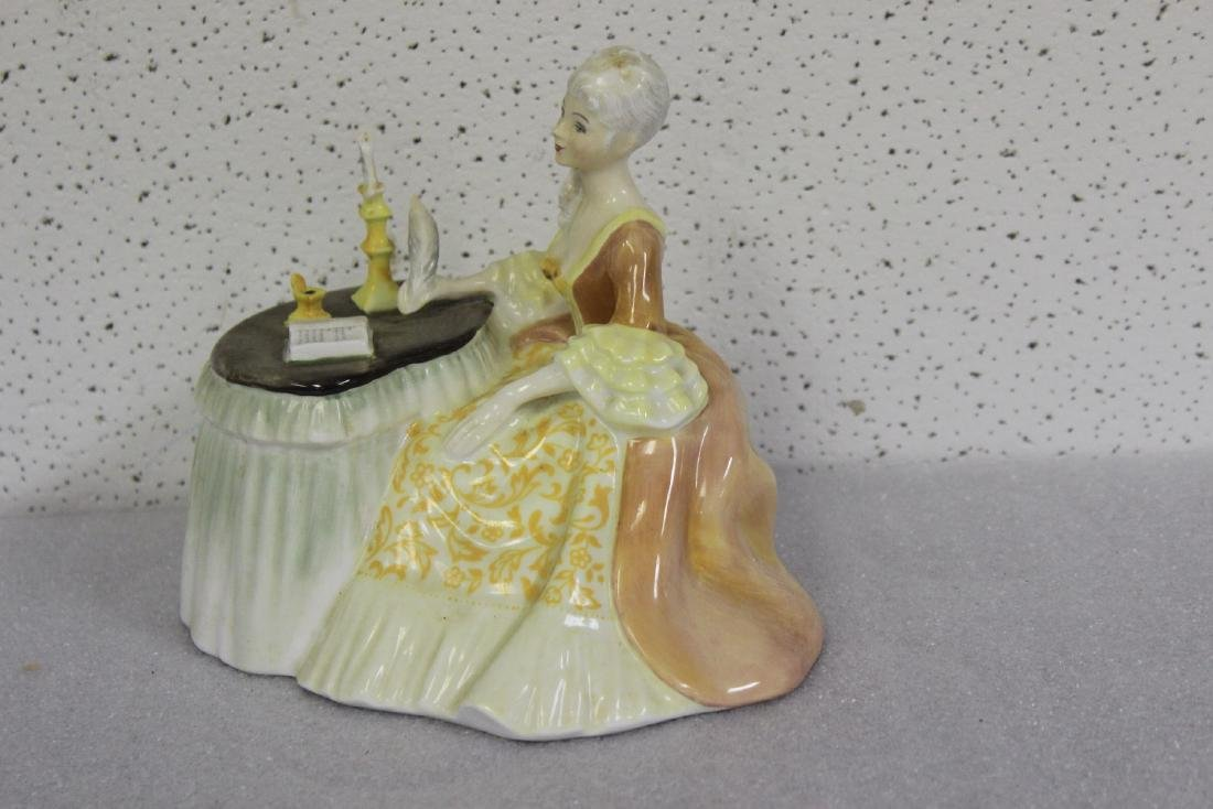 A Royal Doulton Figurine - 4