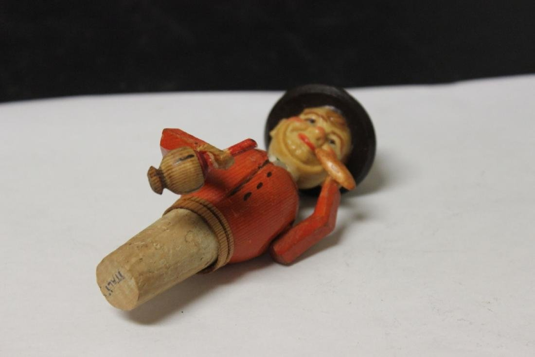 A Wooden Bottle Top with Animated Figure