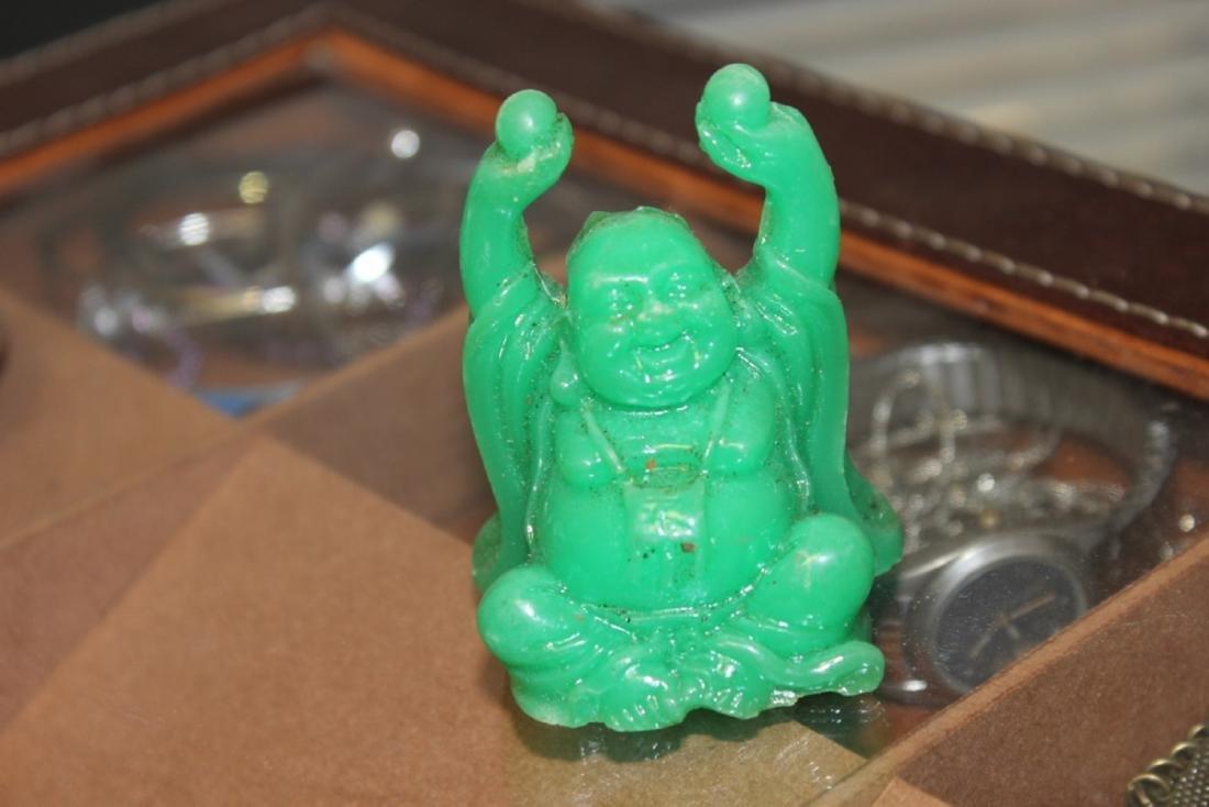 A Green Plastic Buddha