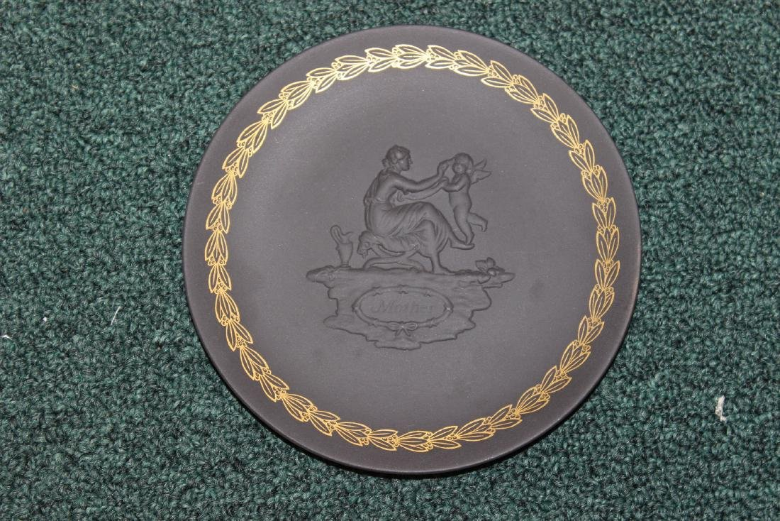 A Black Wedgwood Mother and Cherub Plate