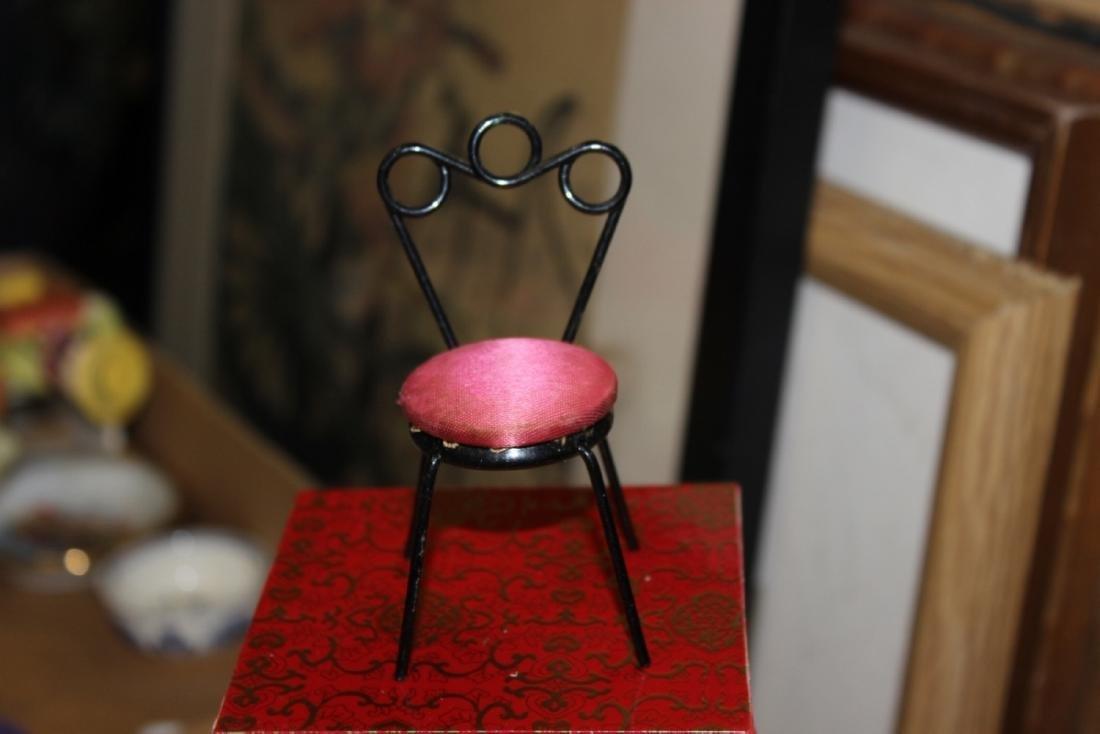 A Miniature Doll House Metal Chair