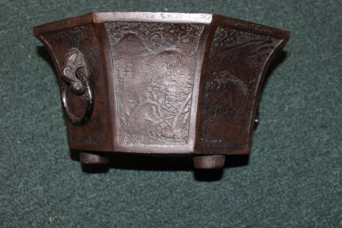 A Chinese Bronze or Cast Iron Plant Pot