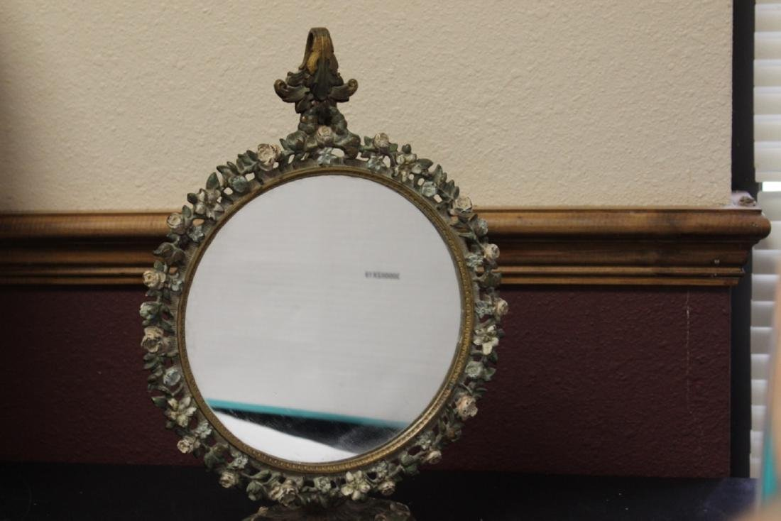 A Metal/Cast Iron Mirror and Stand