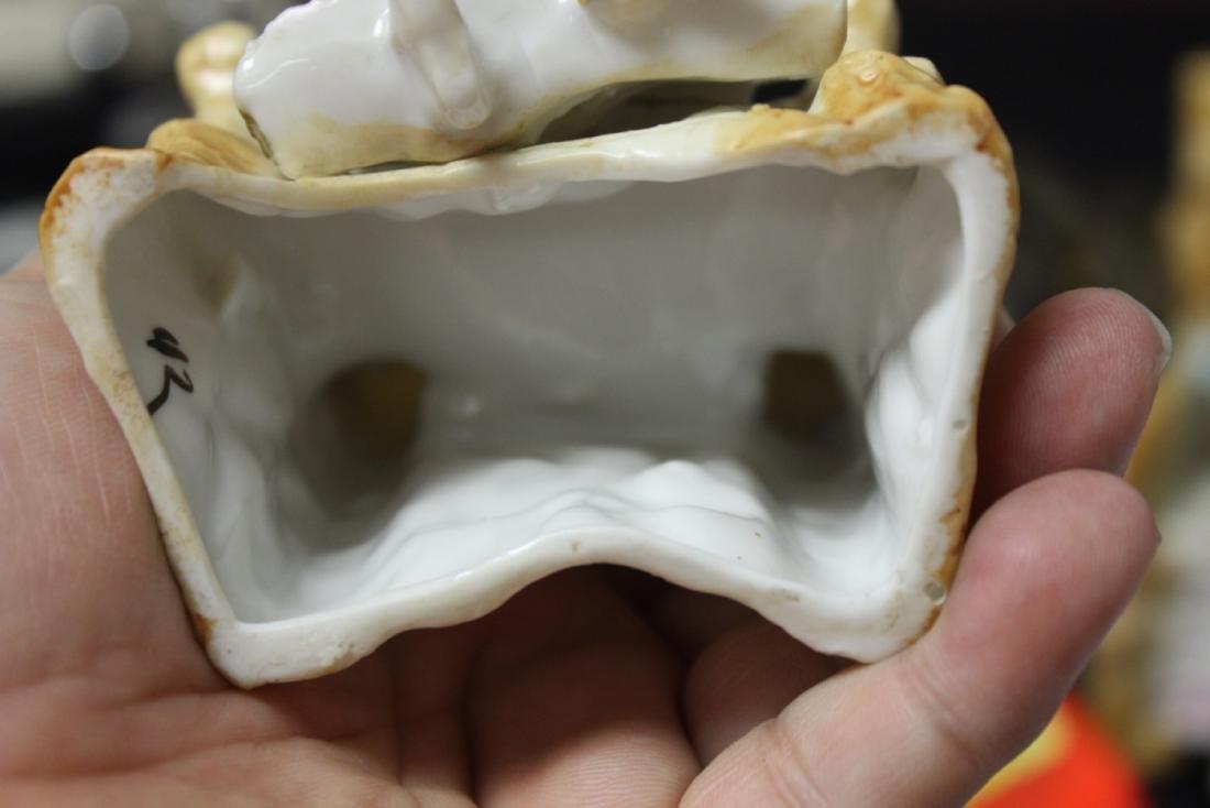 A Seated Ceramic Figure - 8
