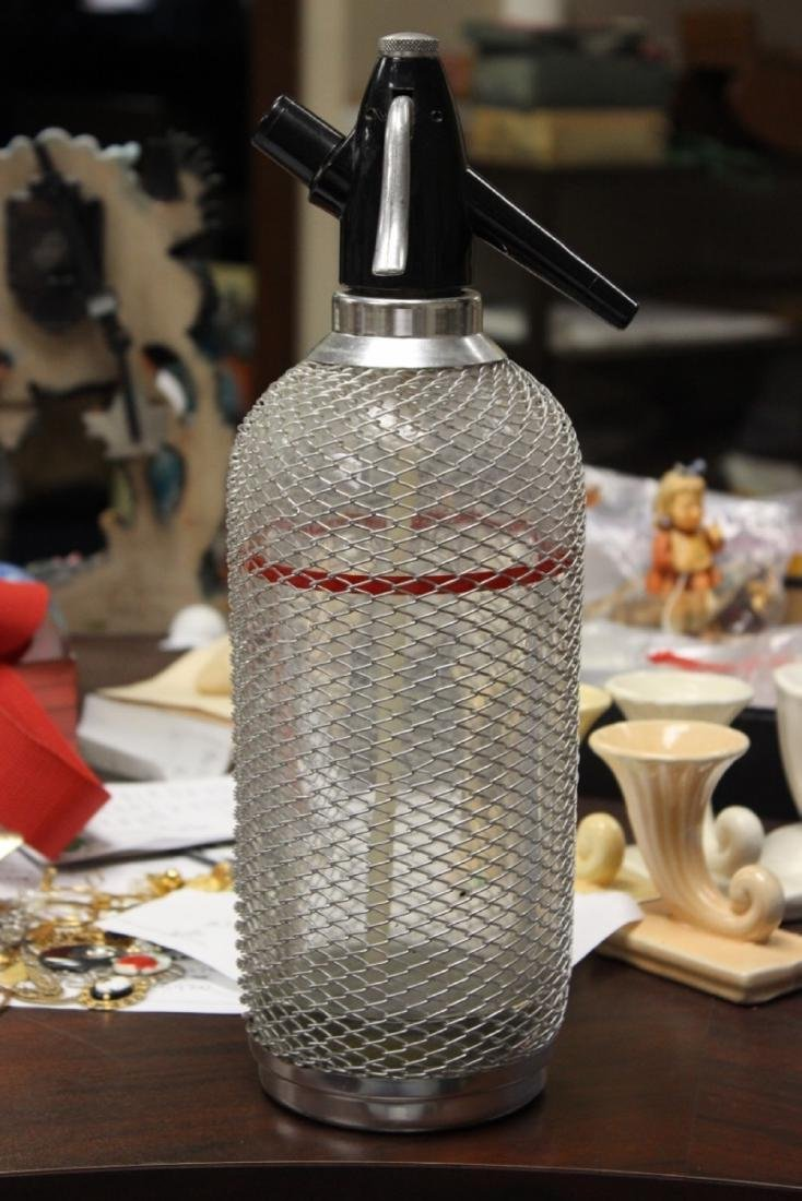A Wire Mesh Seltzer Bottle