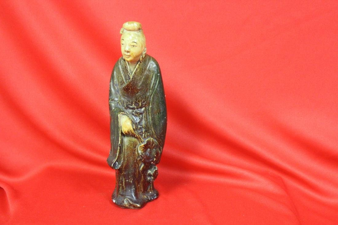 An Old Ceramic Chinese Figurine