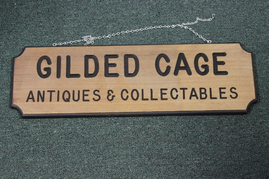 A Wooden Sign on Antiques