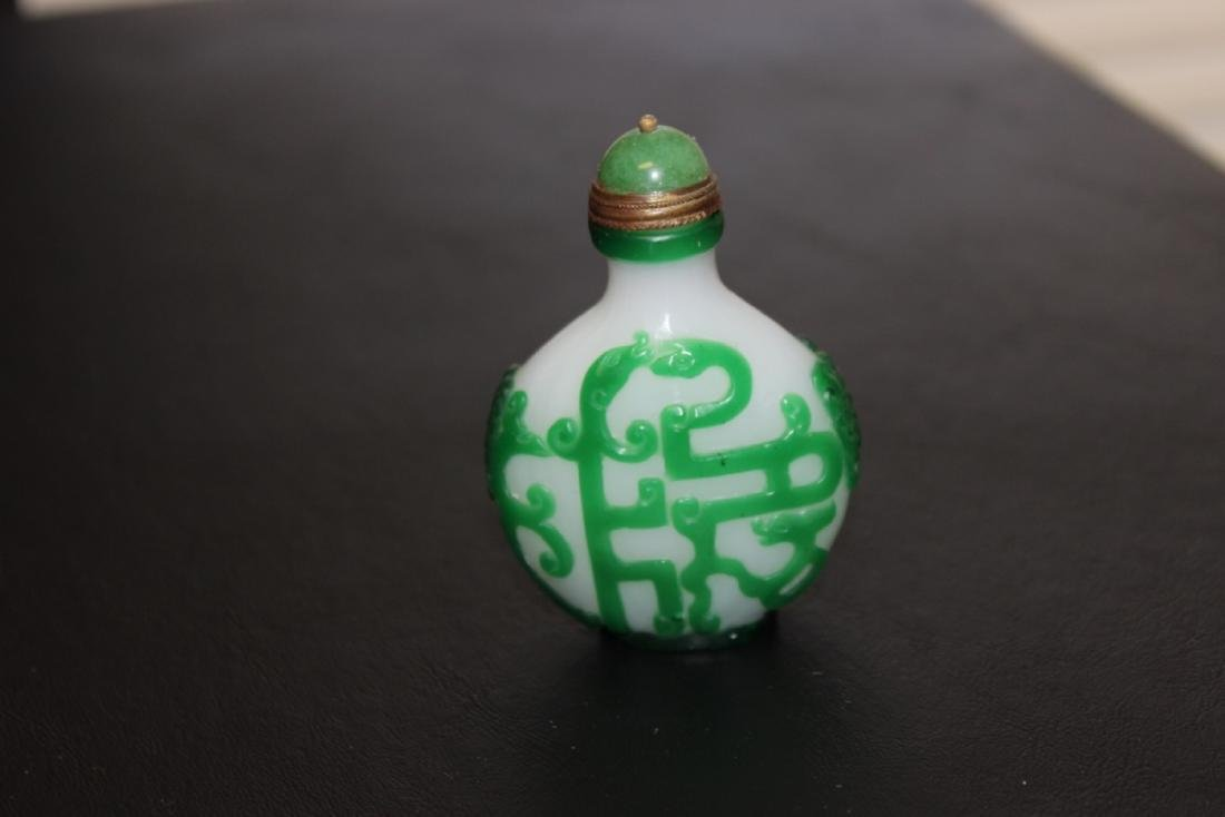 A Carved Peking Glass Chinese Snuff Bottle
