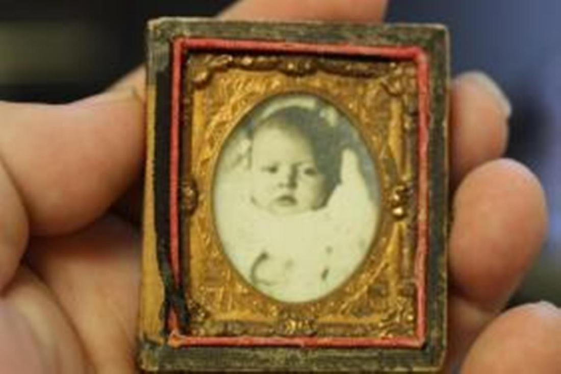 A Small Tin Type Photograph of a Baby