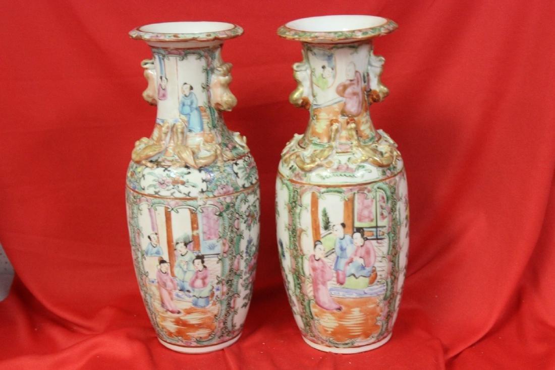 A Pair of Rose Medallion Vases