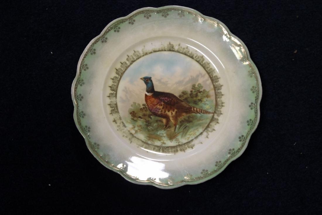 An MZ Austria Plate - Bird Motief (worn)