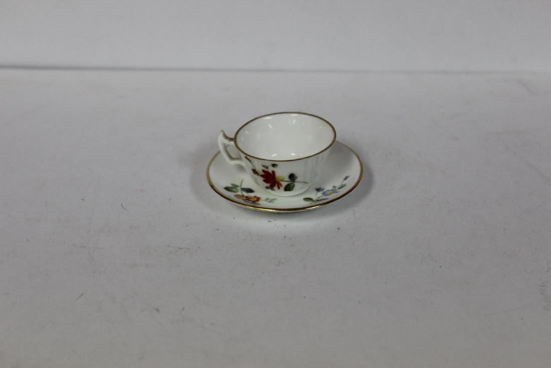 A Miniature Roal Crown Derby cup and Saucer