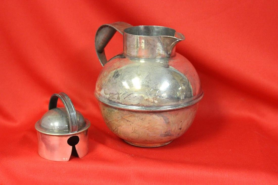 A Silverplated Teapot - 2