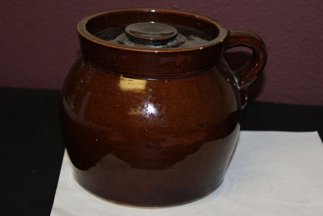 An Antique Lidded Crock With Handle