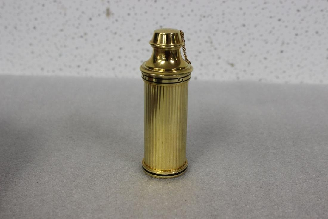 A Cartier Parfum Spray Bottle