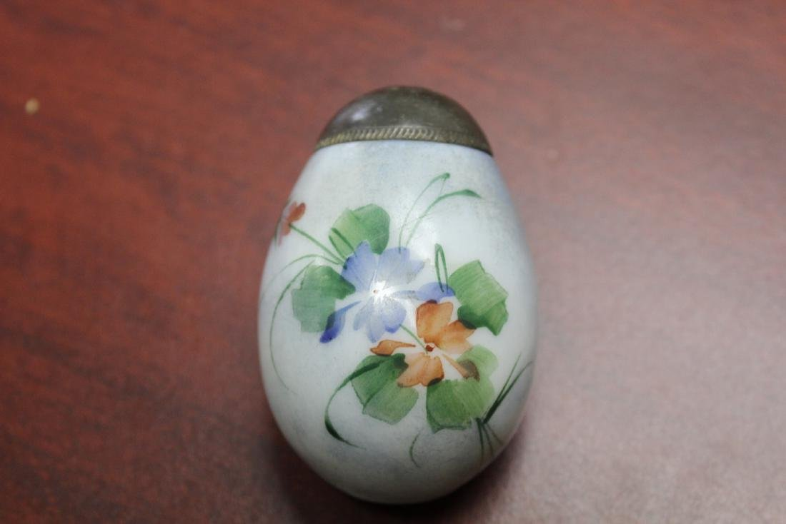 An Egg Form Mount Washington Salt and Pepper Shaker