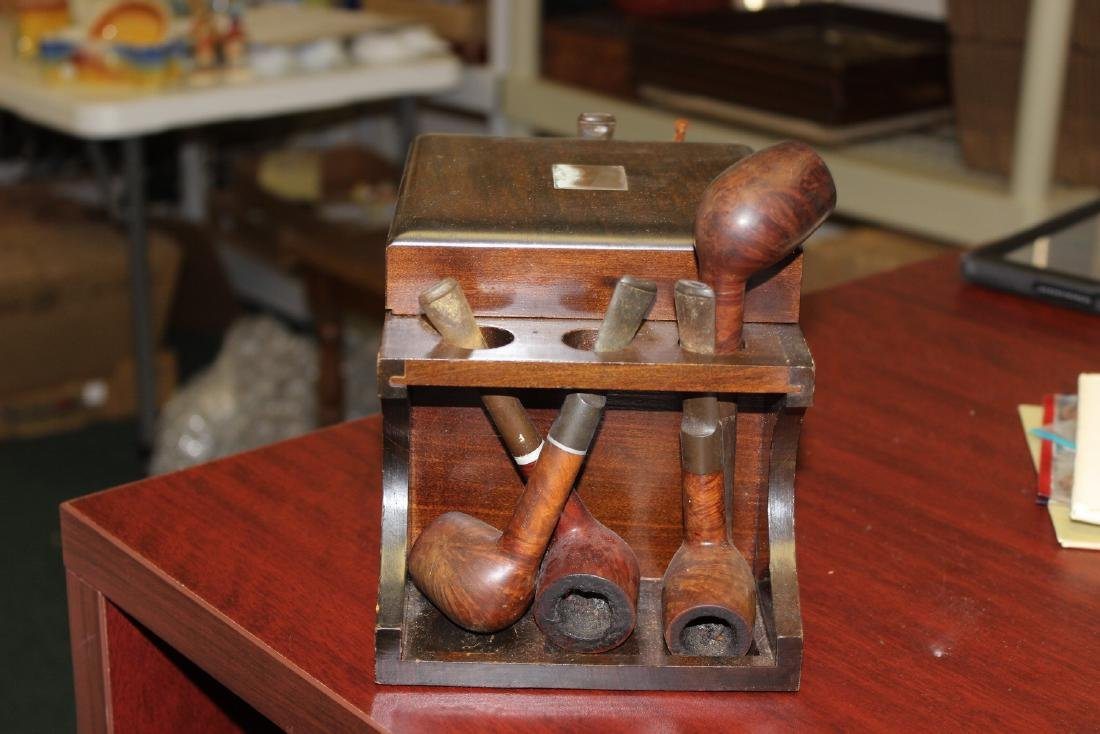 A Wooden Cigar Pipe Holder and Seven Pipes