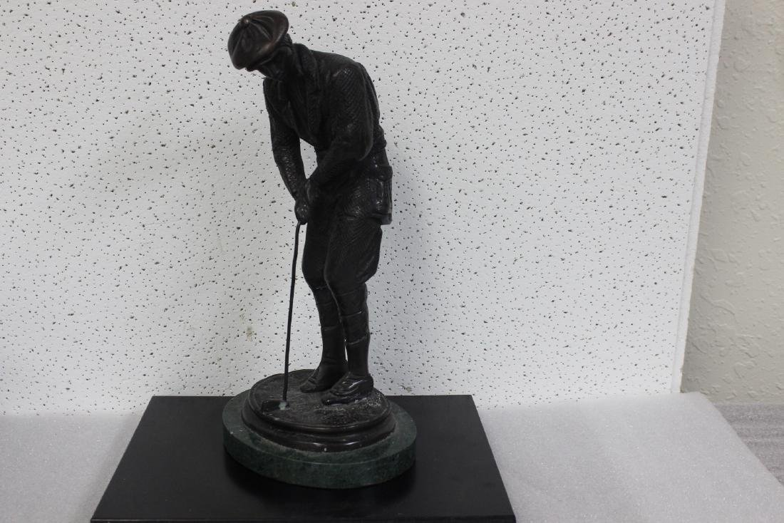 A Bronze Golfer Statue on Marble Base