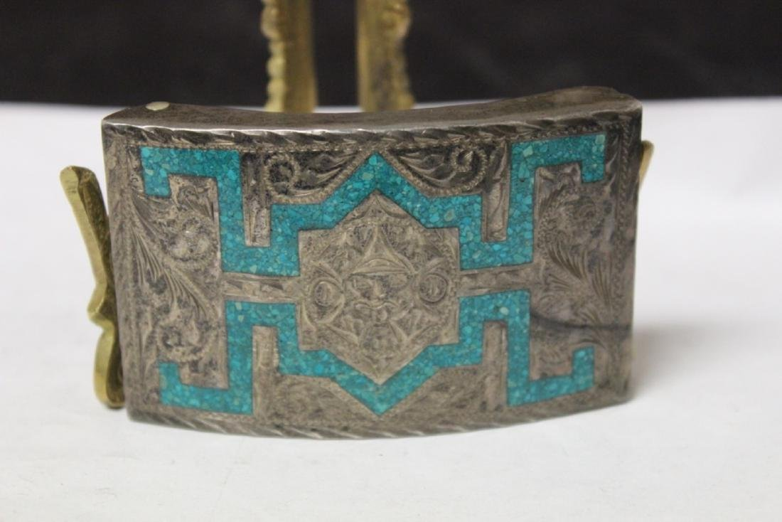 A Sterling and Torquoise inlaid Belt Buckle