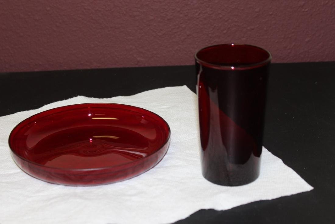 A Ruby Red Glass Cup and Round Tray