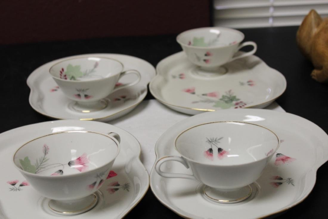 Set of Four Cups and Plates