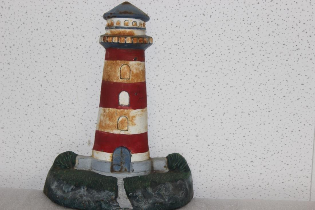 A Vintage Lighthouse Cast Iron Door Stopper