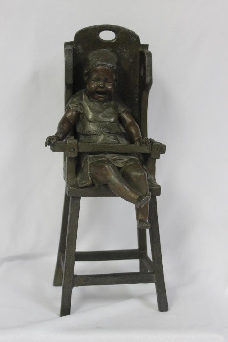 A Bronze Child on a High Chair by Steiner