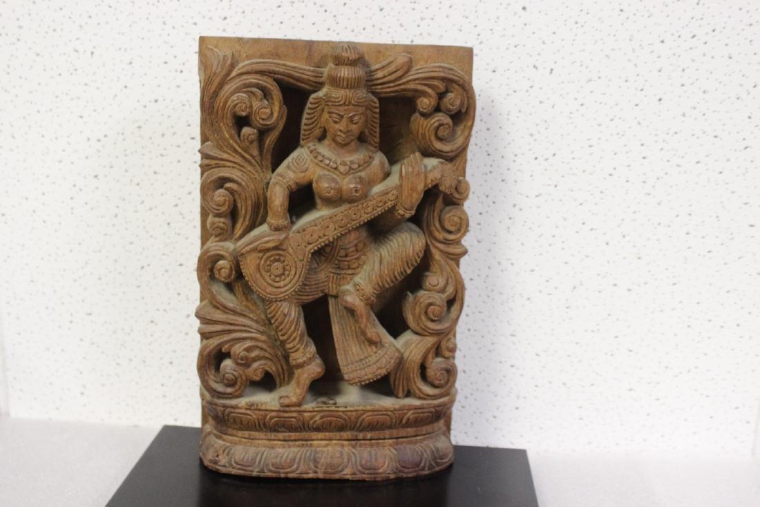 An Oriental Wooden Plaque