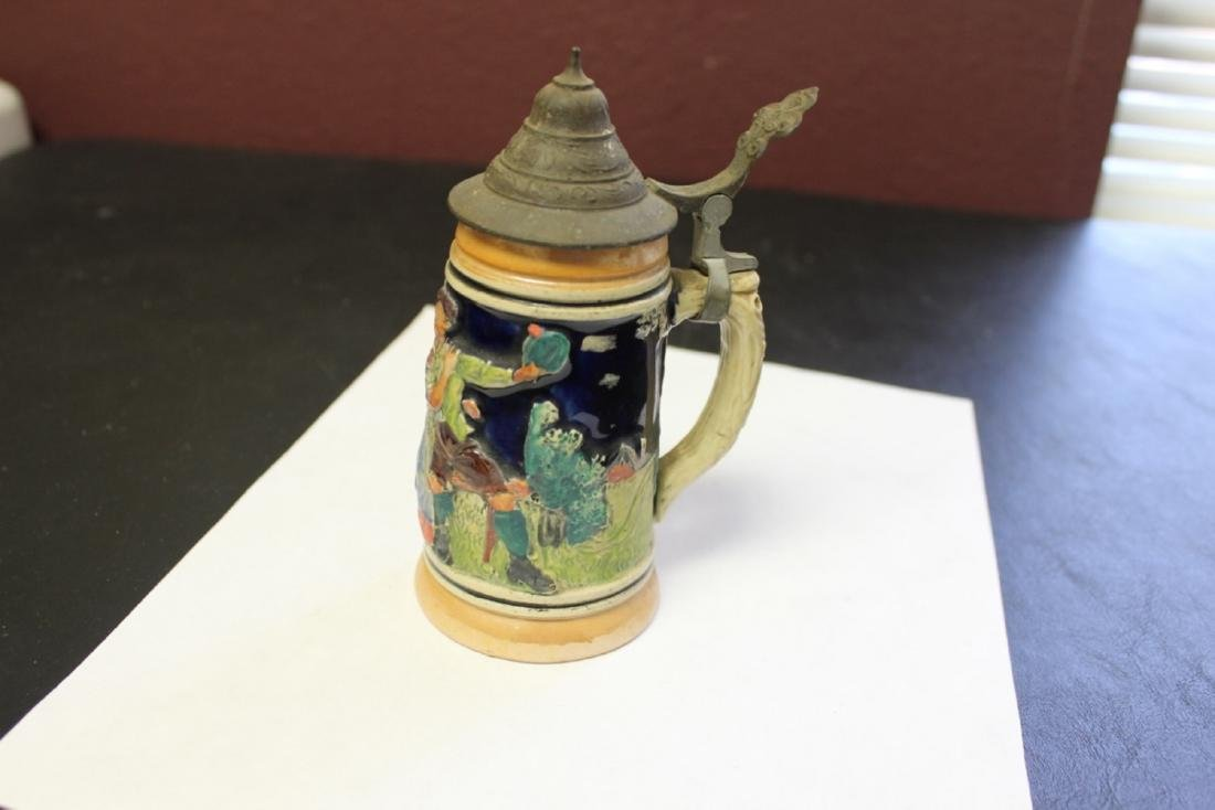 A Small German Stein With Lid