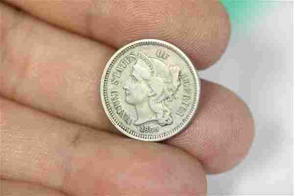 An 1860 US 3 Cent Piece