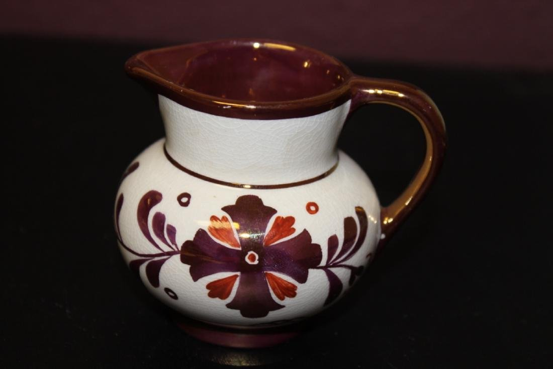 An Old Castle Copper Ceramic Luster Creamer