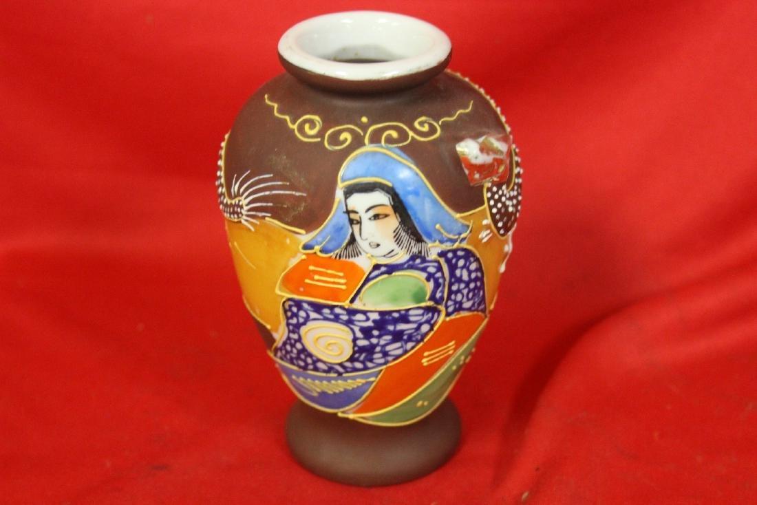 An Early Japanese Raised Dragon Vase