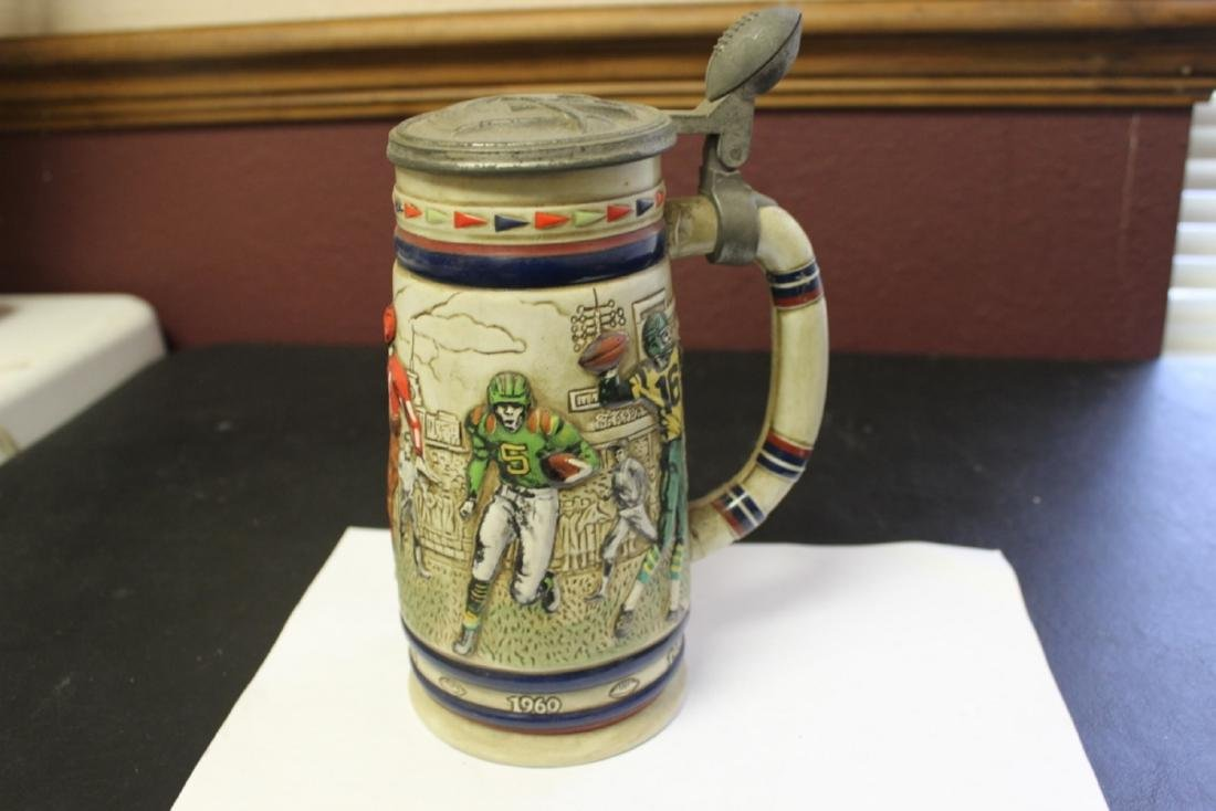 An Avon 1983 Great American Football Stein