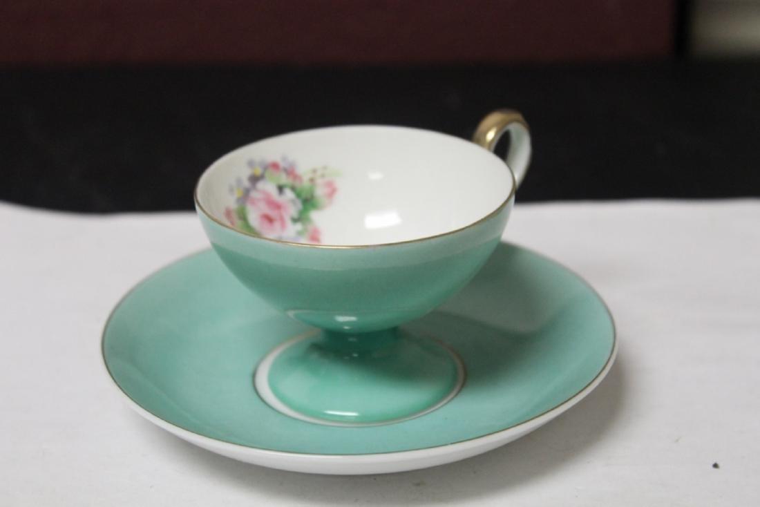 A Noritake Cup and Saucer