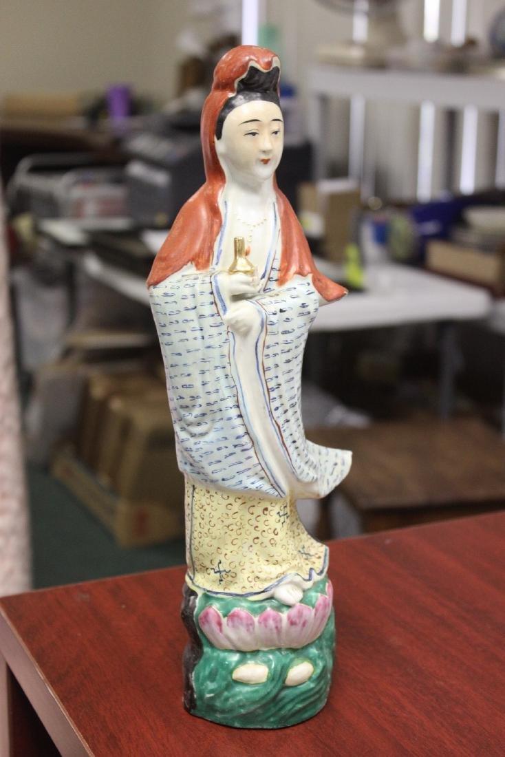 A Chinese Porcelain Figure of a Kwan Yin