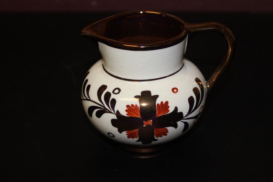 An Old Castle Copper Ceramic Luster Creamer