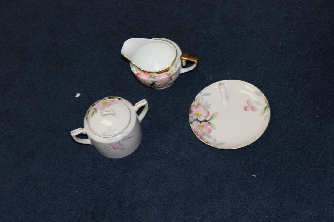 An Azalea Pattern Creamer and Sugar and Nut Dish