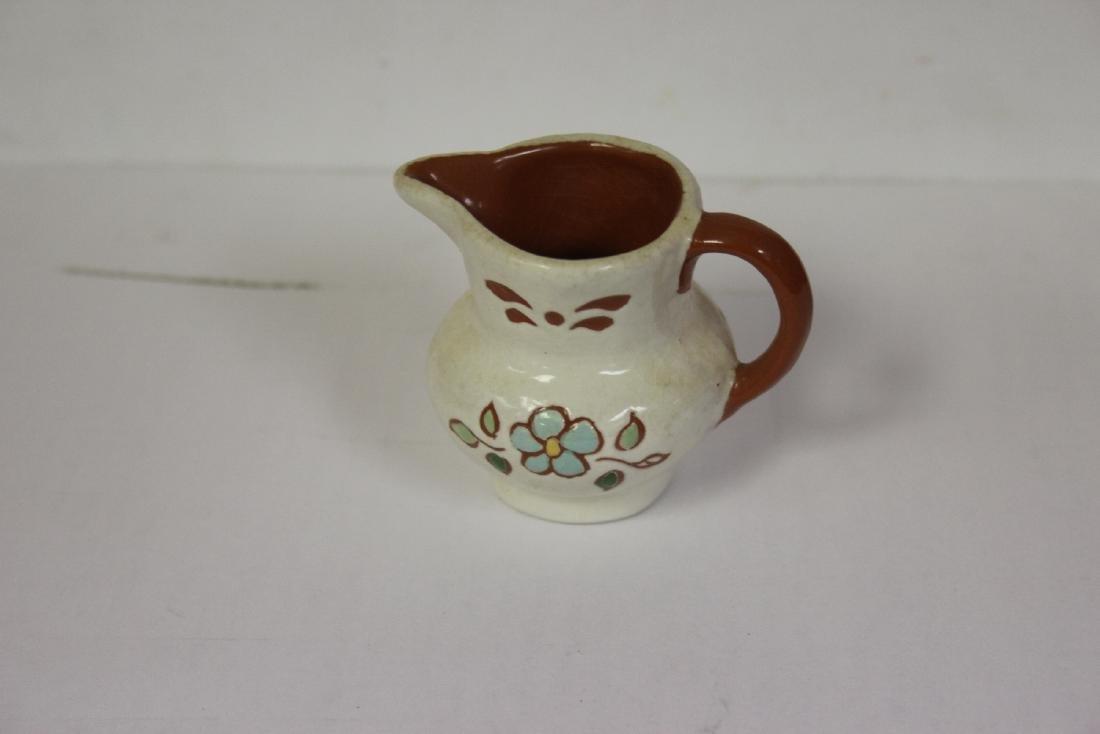 A Miniature Ceramic Pitcher