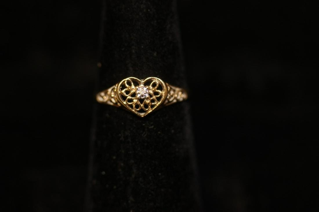 A 10 Kt Gold and Diamond Heart Ring