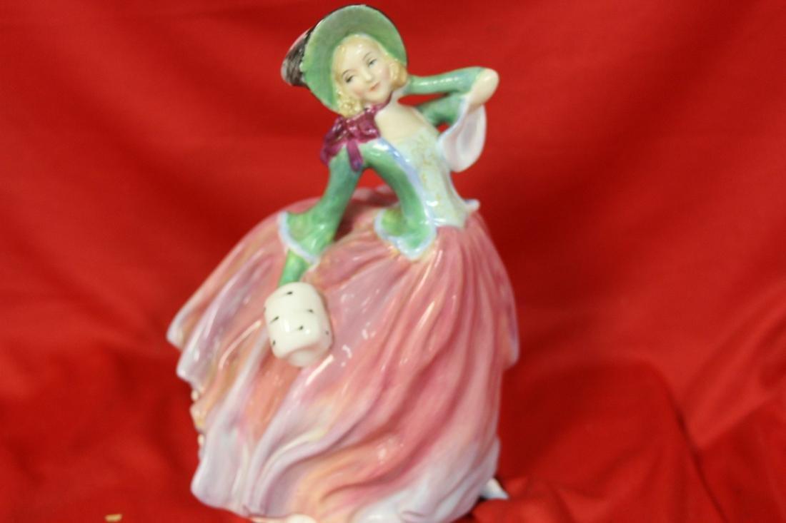 "A Royal Doulton Figurine - ""Autumn Breezes"""