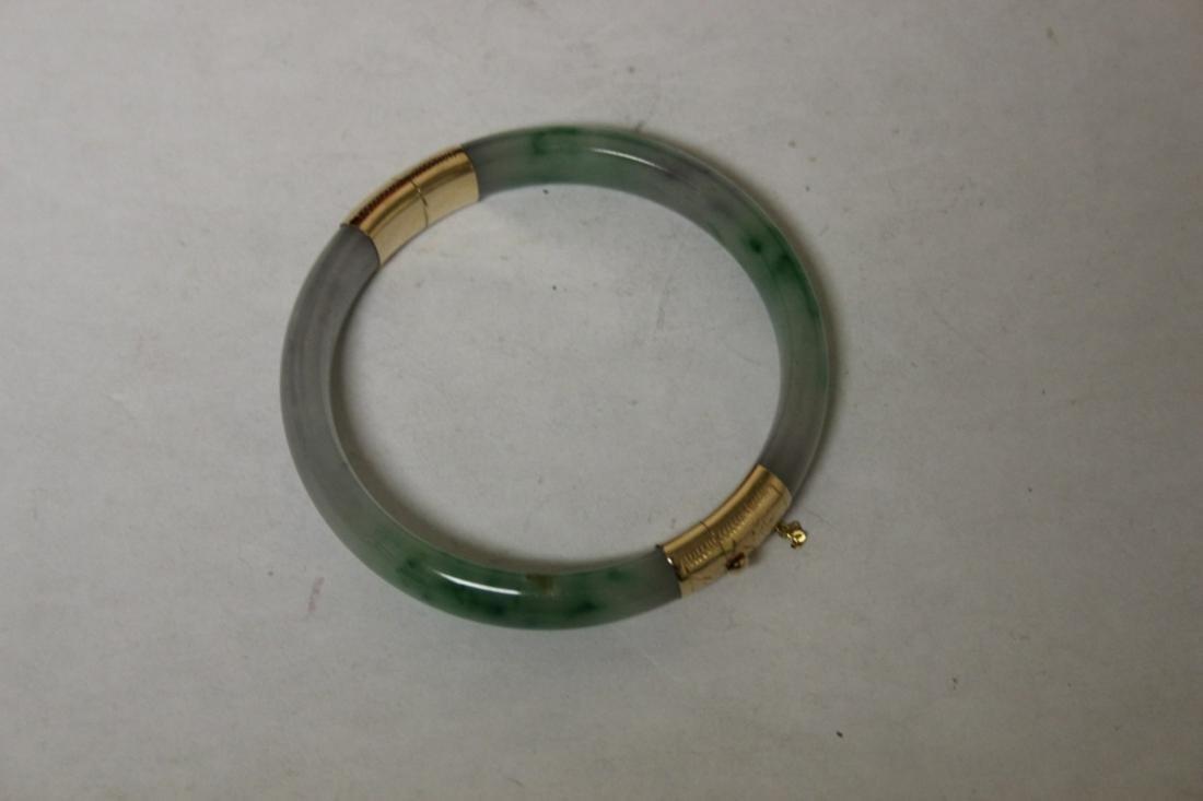 A 14Kt Gold Jade Bangle Bracelet