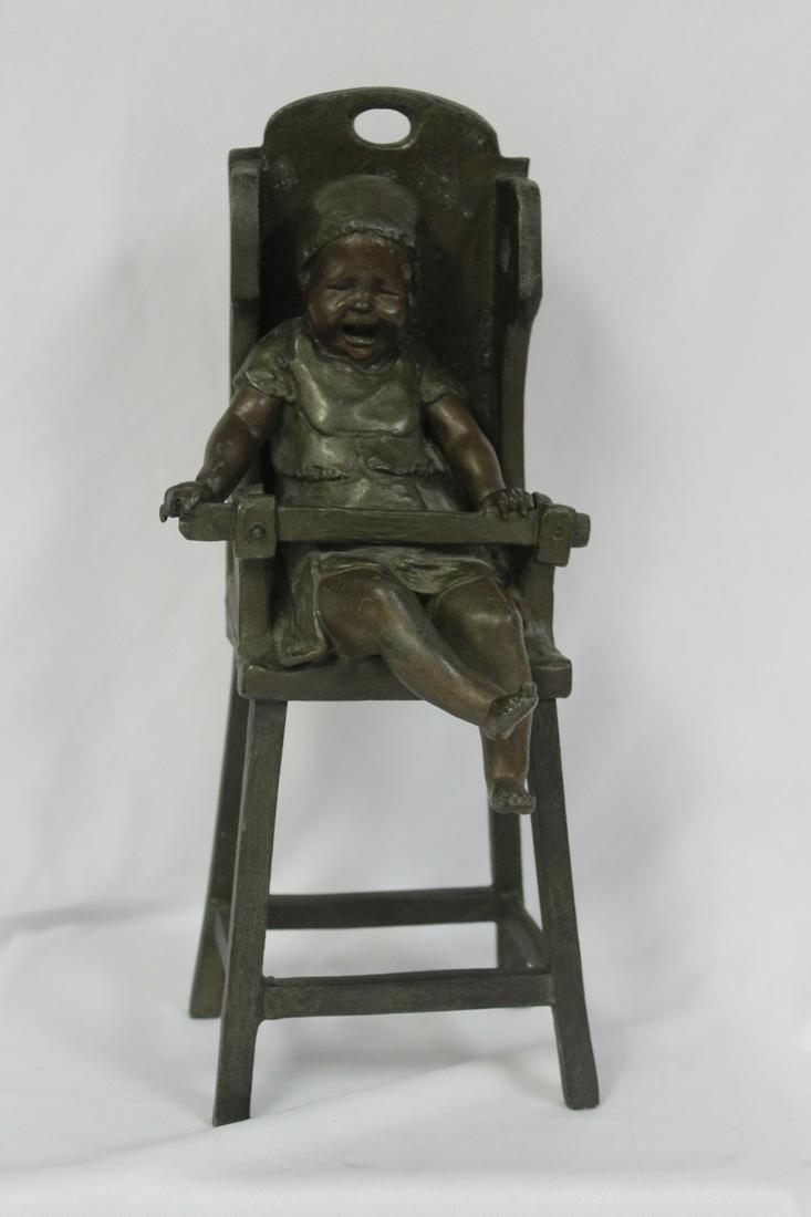 A Bronze Child on a High Chair by Steiner