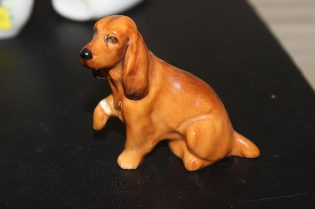 A Small Royal Doulton Miniature Dog