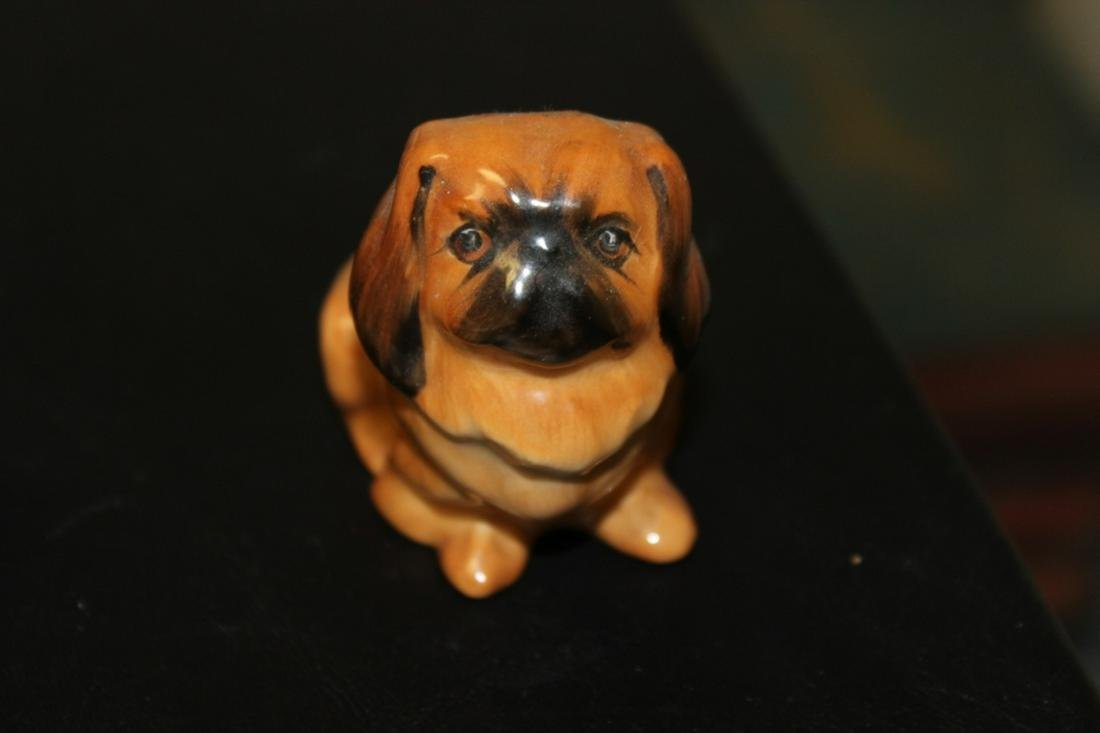 A Small Royal Doulton Miniature Pekignese Dog