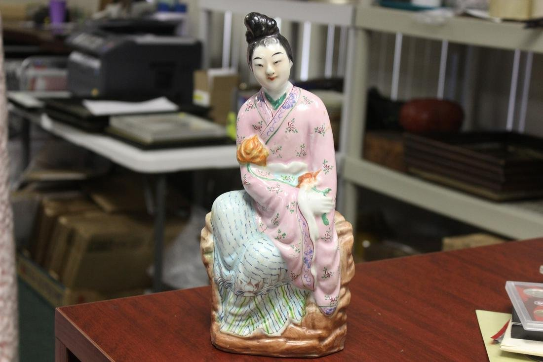 A Chinese Porcelain Figure of a Lady